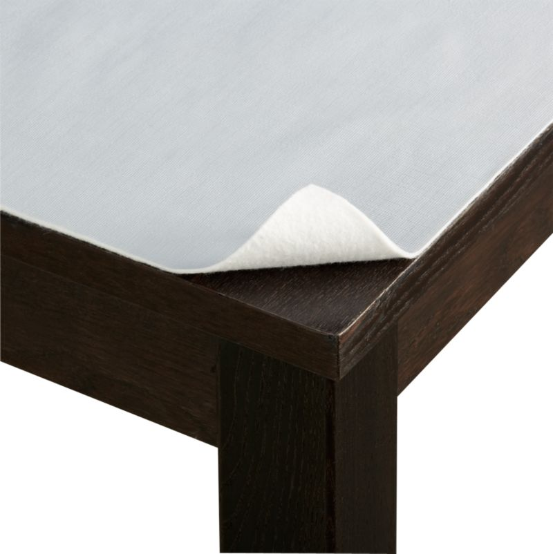 Concealed beneath table linens, our grey PEVA pad with embossed texture is liquid-proof and prevents dings and scratches. Pad cuts to fit and protect almost any table, stores in its reusable pouch.<br /><br /><NEWTAG/><ul><li>PEVA with polyester backing</li><li>Clean top with soap and water; spot clean reverse</li><li>Trim to fit</li><li>Made in China</li></ul>