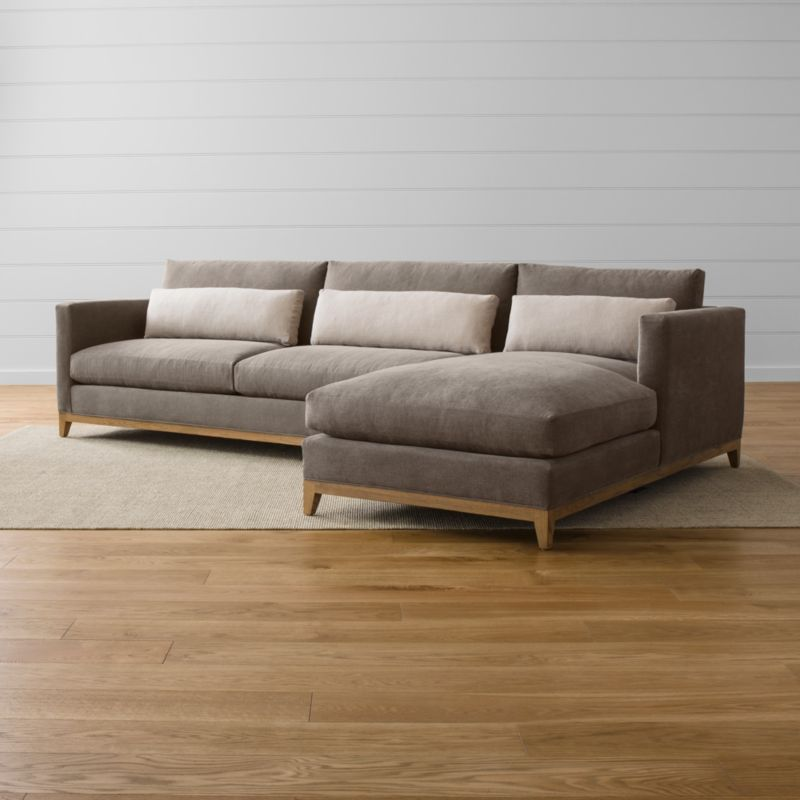 Relaxing all conventions about living room furnishings, our Taraval 2-piece sectional sofa is a casual, yet elegant, seating option. The left arm sofa and right arm chaise, along with their Taraval sectional family members, are upholstered in all-natural cotton with an exposed solid oak base taking on a relaxed attitude in a grey, weathered finish. Stonewashed kidney cushions in 100 percent linen hug your lower back in comfort. <NEWTAG/><ul><li>Frames are benchmade with eco-friendly, certified sustainable hardwood that's kiln-dried to prevent warping</li><li>Solid oak legs and bases in a weathered grey finish</li><li>Eight-way, hand-tied spring suspension system</li><li>Soy-based polyfoam seat cushions with innerspring coil system, wrapped in polyfiber and feather-down blend and encased in downproof ticking</li><li>Polyfiber and feather-down blend back cushions and kidney pillows encased in downproof ticking</li><li>Includes 3 kidney pillows</li><li>Made in North Carolina, USA</li></ul><br />