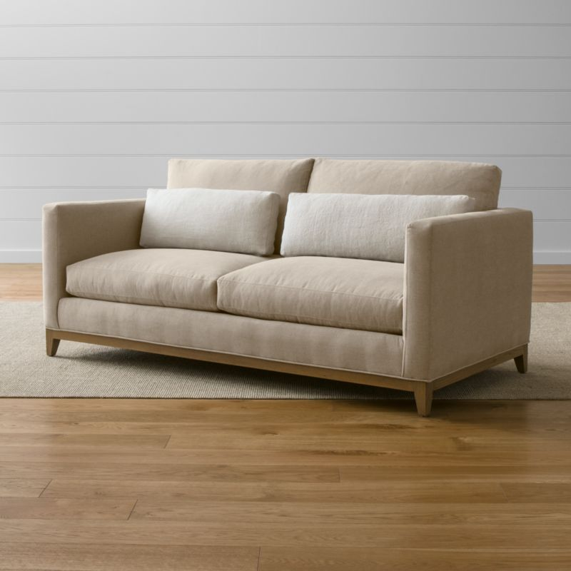 Our Taraval apartment sofa relaxes all conventions about what a living room sofa can be. Casual, yet elegant, it's upholstered in all-natural cotton with stonewashed 100% linen kidney cushions to hug your lower back in comfort. <NEWTAG/><ul><li>Frame is benchmade with certified sustainable hardwood that's kiln-dried to prevent warping</li><li>Solid oak legs and base in a weathered grey finish</li><li>Eight-way, hand-tied spring suspension system</li><li>Soy-based polyfoam seat cushions with innerspring coil system, wrapped in polyfiber and feather-down blend and encased in downproof ticking</li><li>Polyfiber and feather-down blend back cushions and kidney pillows encased in downproof ticking</li><li>Includes 2 kidney pillows</li><li>Made in North Carolina, USA of domestic and imported materials</li></ul>