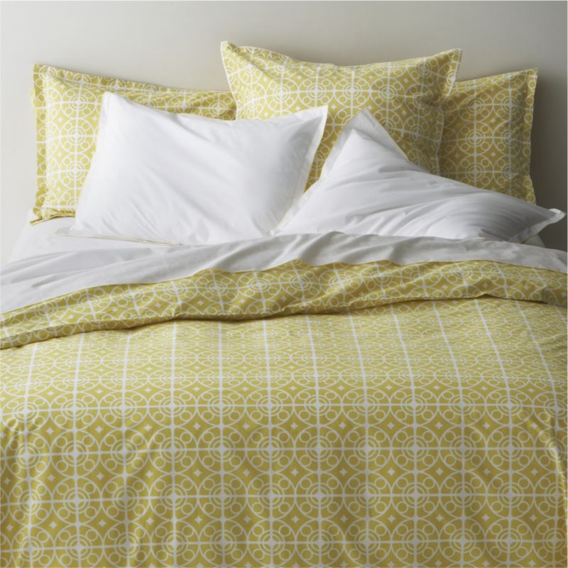 White medallions trellis on citron in soothing geometrics inspired by Moroccan tiles. Reversible duvet cover features a hidden button closure at the bottom and interior fabric ties to hold the insert in place. Duvet inserts and bed pillows also available.<br /><br /><NEWTAG/><ul><li>100% cotton percale</li><li>200-thread-count</li><li>Machine wash cold, tumble dry low</li><li>Made in Portugal</li></ul>