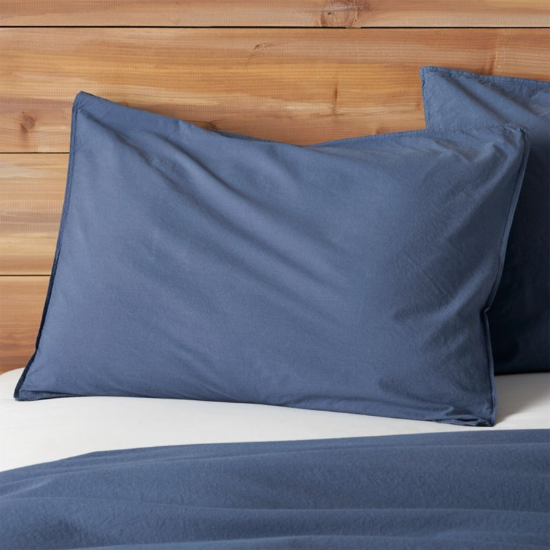 Soft, casual stonewashed cotton linens embrace the bed in a gorgeous shade of blue, a perfect solid for mixing and matching with our print collections. Pillow shams have inside flap closure. Bed pillows also available.<br /><br /><NEWTAG/><ul><li>100% cotton percale</li><li>200-thread-count</li><li>Machine wash cold; tumble dry low; warm iron as needed</li><li>Do not bleach</li><li>Inside flap closure</li><li>Made in Portugal</li></ul>