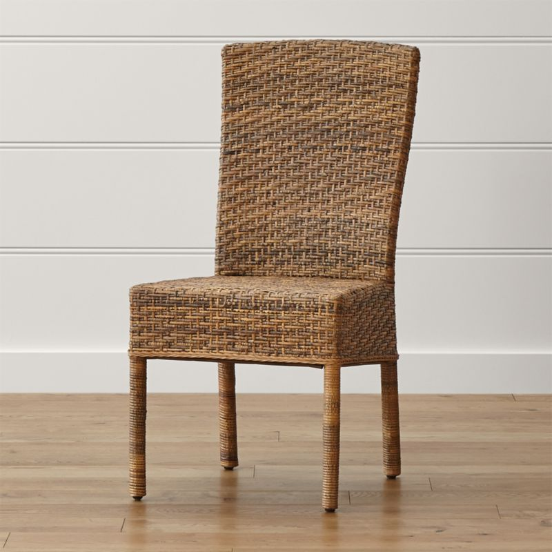 The particular species of rattan used in the Tigris Side Chair has mottled honey tones that resemble a tiger's coat. Handwoven natural rattan peel is woven over a solid mahogany frame in a tropical rendition of the Parsons style chair. <NEWTAG/><ul><li>Mahogany wood frame</li><li>Natural rattan peel surface</li><li>Tongue-and-groove joinery</li><li>Clear protective lacquer finish</li><li>Floor protectors</li><li>Made in Indonesia</li></ul><br />