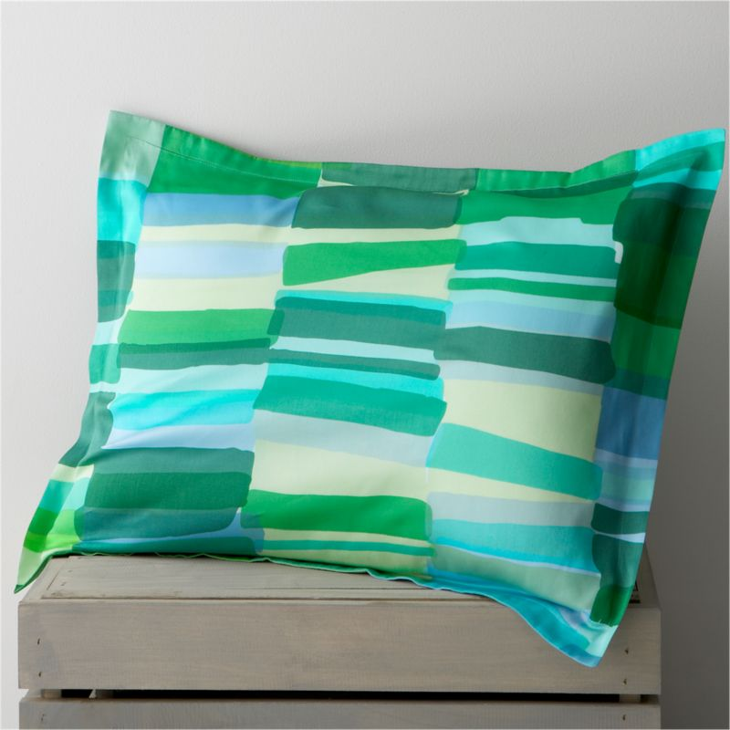 """Tilkkula (""""scrap"""") overlaps artfully irregular rectangles in a sea-inspired palette, designed by Erja Hirvi in 2006. Ultra-soft 300-thread-count cotton sateen sham has a 1"""" flange and generous overlapping flap closure on the back. Bed pillows also available.<br /><br /><strong>Limited-time offer ends February 20, 2013.</strong><br /><br /><NEWTAG/><ul><li>Pattern designed by Erja Hirvi; 2006</li><li>100% cotton sateen</li><li>300-thread-count</li><li>Machine wash cold, tumble dry</li><li>Made in Pakistan</li></ul>"""
