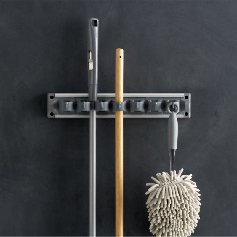 """We've partnered with the """"beautiful house"""" experts at Casabella® to bring you our exclusive curated line of household cleaning essentials. For the smartest utility storage, this ingeniously designed gripper in our exclusive grey holds up to 13 cleaning tools, cloths, garden implements and more in a minimum of space. Soft rubber grips hold items securely while allowing easy placement and removal.<br /><br />Casabella® was founded in 1988 when Bruce Kaminstein discovered a unique mop in Italy, which inspired his vision for expertly crafted, custom utility designs that are as beautiful as the homes they clean.<br /><br /><NEWTAG/><ul><li>Designed exclusively for Clean Slate™ by Casabella®</li><li>Crafted of nylon, polypropylene, steel and aluminum</li><li>Holds up to 13 items</li><li>Clean with a damp cloth</li><li>Made in China</li></ul>"""