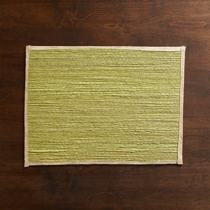 Gorgeous color and the organic texture of palm fiber are showcased in rustic handwoven placemats, edged in a natural border. Wax coating helps to seal in the color. Due to its handcrafted nature, each placemat is unique and color may vary.<br /><br /><NEWTAG/><ul><li>Handcrafted</li><li>98% palm fiber and 2% string</li><li>Not colorfast for soaking</li><li>Clean with damp cloth, air dry</li><li>Made in Mexico</li></ul>