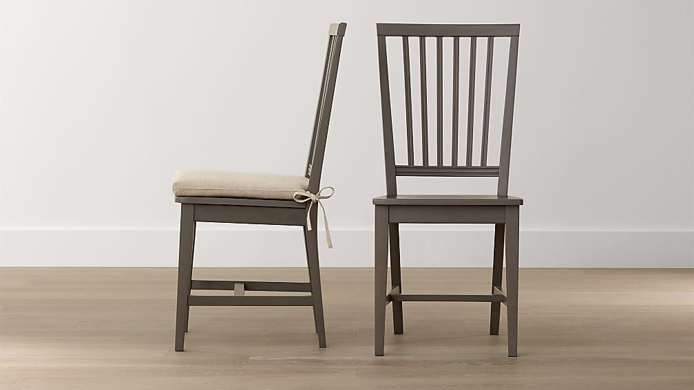 village grigio wood dining chair and natural cushion crate and barrel