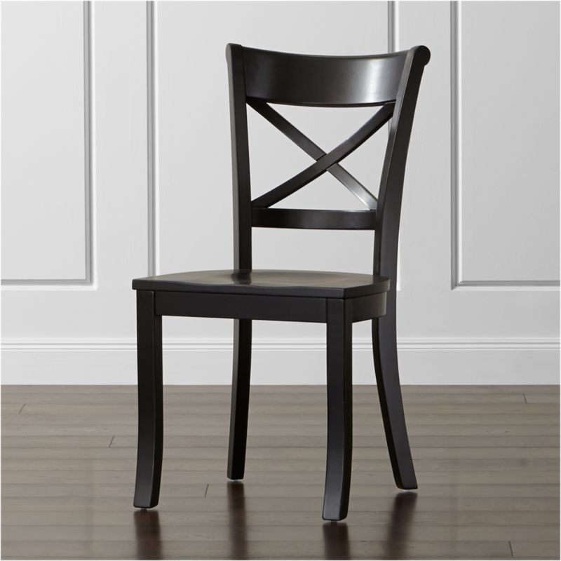 """With its contoured """"X"""" back and comfortable, carved seat, our Vintner side chair supports you in all the right places. With a substantial farmhouse aesthetic, this classic side chair is crafted of solid wood with a painted black finish that's hand-rubbed at the edges for a lived-in look. <NEWTAG/><ul><li>Sustainable solid rubberwood</li><li>Black-painted, antiqued and hand-rubbed finish with red undertones and clear lacquer topcoat</li><li>Made in Vietnam</li></ul>"""