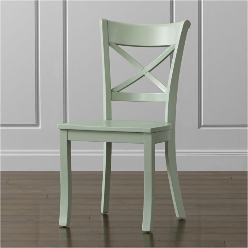 """Inspired by the substantial kitchen and dining chairs of farmhouses past, our classic Vintner side chair supports you in all the right places with its """"X"""" back and comfortable, carved seat. With sustainable solid wood construction and a retro mint green painted finish, this charming, comfortable chair lends the look of an inherited family piece or flea market find to any setting. The Vintner Mint Side Chair is a Crate and Barrel exclusive.<br /><br /><NEWTAG/><ul><li>Sustainable solid rubberwood</li><li>Mint green painted finish with clear lacquer topcoat</li><li>Made in Vietnam</li></ul><br /><br />"""