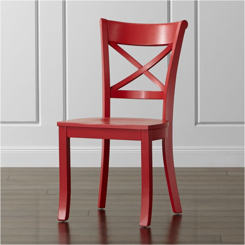 "This vibrant version of our classic Vintner farmhouse-style chair takes the solid, sustainable wood construction with contoured ""X"" back and comfortable, carved seat and paints it in eye-catching red. Familiar, retro styling makes the Vintner side chair an instant member of the family. The Vintner Red Side Chair is a Crate and Barrel exclusive.<br /><br /><NEWTAG/><ul><li>Sustainable solid rubberwood</li><li>Red painted finish with clear lacquer topcoat</li><li>Made in Vietnam</li></ul><br /><br />"