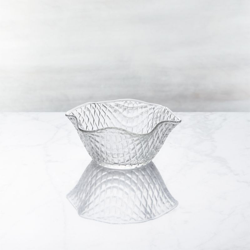 Unabashedly old-time looks put the social in serving ice cream. Everyone's favorite frozen treat gets star treatment cradled in a waffle-weave glass dish with ruffle rim, crafted of molded glass. Also great for candies or nuts.<br /><br /><NEWTAG/><ul><li>Glass</li><li>6.8 oz.</li><li>Dishwasher- and freezer-safe</li><li>Made in Italy</li></ul>