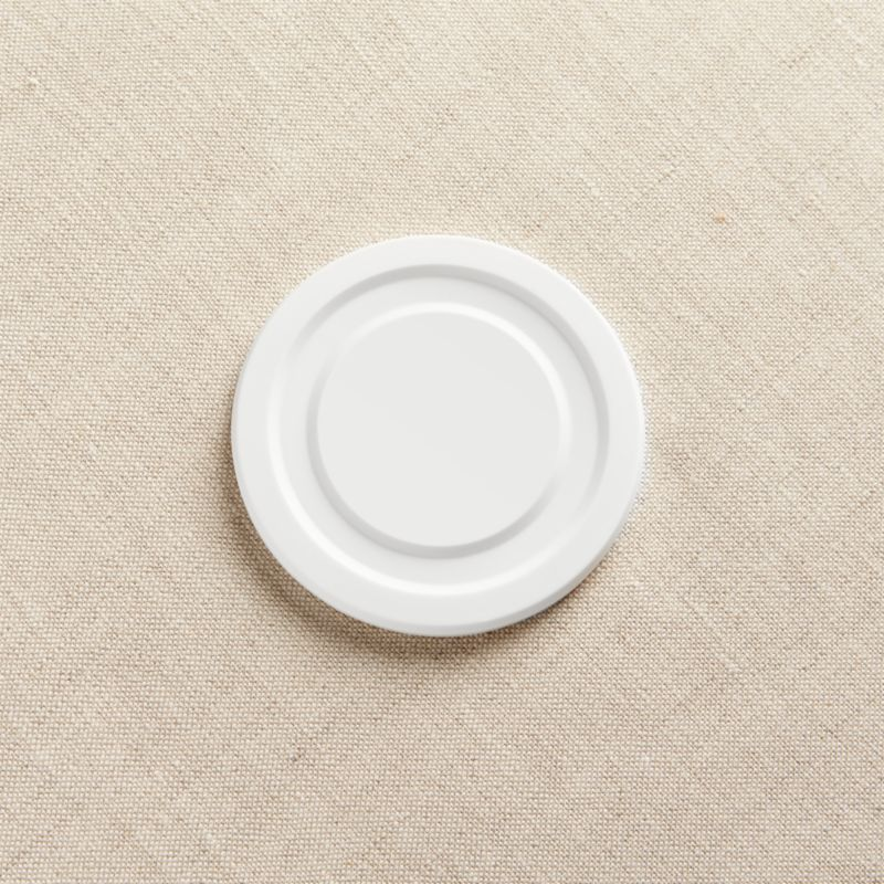 This optional plastic lid for our popular Working Glass collection seals in beverages and foods on the small, large, and tall sizes.<br /><br /><NEWTAG/><ul><li>Plastic</li><li>Top-rack dishwasher-safe</li><li>Made in USA</li></ul>