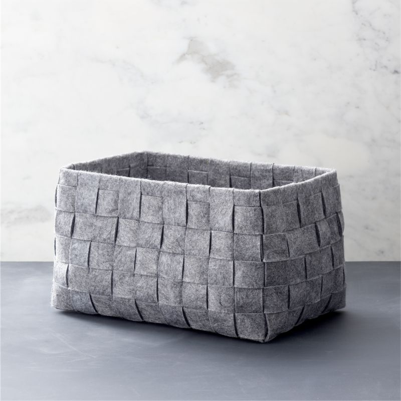 A classic basketweave design is reimagined in heathered grey felt, creating a soft, neutral statement in open storage. A natural in any room.<br /><br /><NEWTAG/><ul><li>100% polyester</li><li>17.5-lb. capacity</li><li>Dry clean</li><li>Made in China</li></ul>