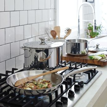 Stovetop with food cooking.