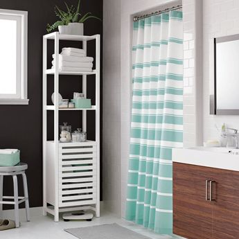 Bathroom with a striped shower curtain and storage shelf.