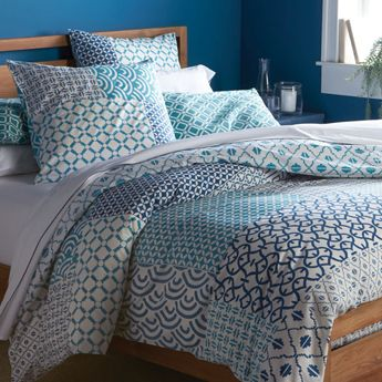Full/Queen bed with bedding.