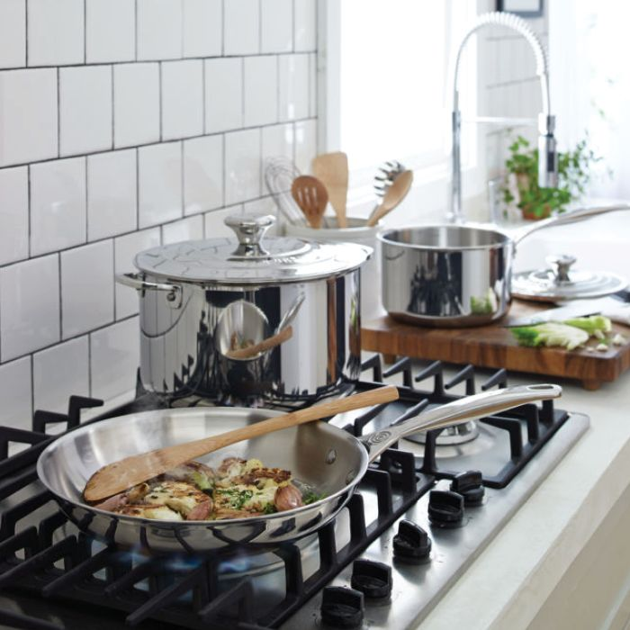 Stovetop with food cooking