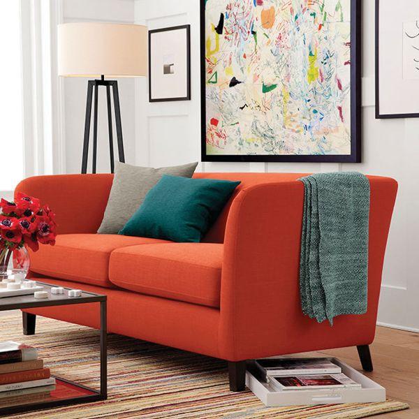 Living room with an orange sofa.