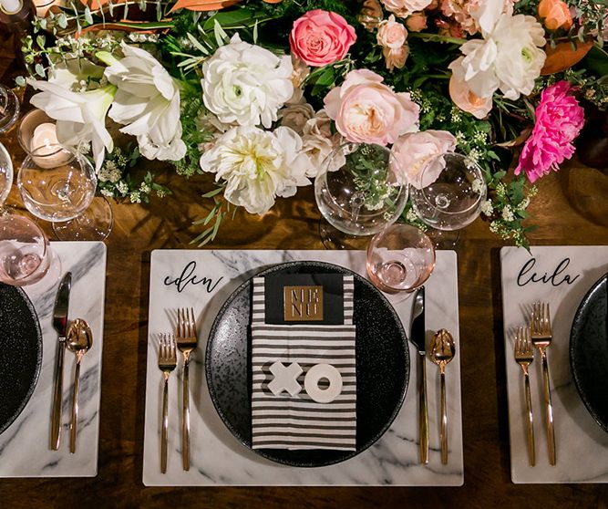 view their registry picks a table set with wine glasses and a floral arrangement