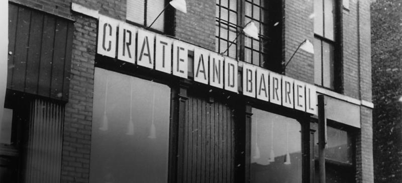 a warehouse building with crate and barrel signs on top