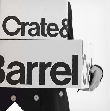 Picture of someone holding Crate and Barrel boxes