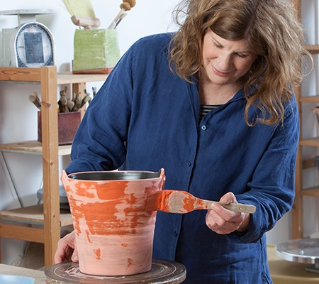 Kathy Erteman working on clay