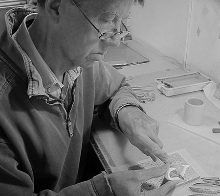 Martin Hunt carving a mug handle