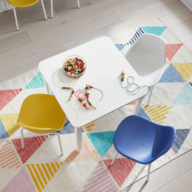 Kids play table with colorful chairs