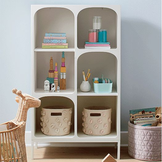 Bookcase featuring colorful decor