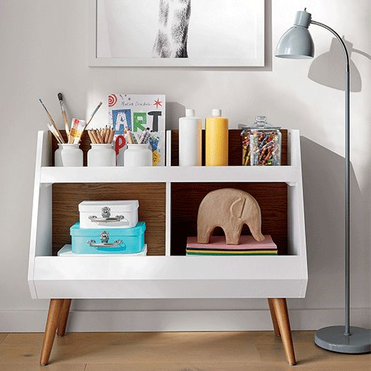 Multi-purpose bookcase with colorful paint supplies
