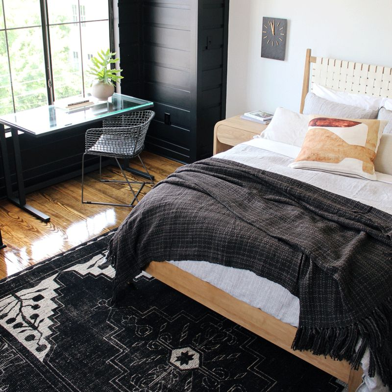 Styled bed with desk facing window