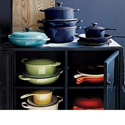 Assorted Le Creuset cookware in Caribbean, Ink, Palm, Flame, Cherry, Cream and Soleil colors