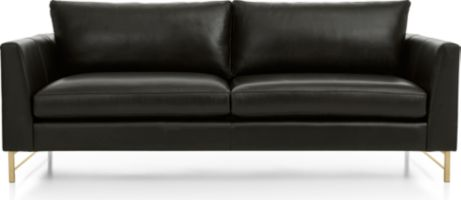 Tyson Leather Sofa with Brass Base shown in Logan, Smoke