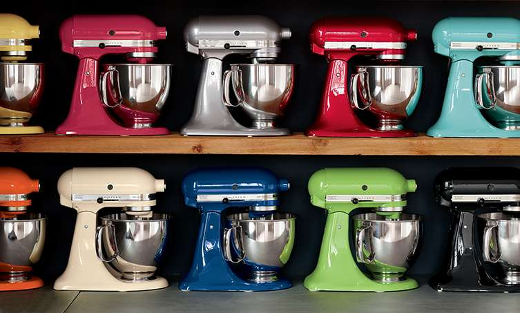 KitchenAid Artisan Stand mixers on shelves in various colors such as Aqua, Black and Watermelon
